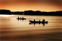 Image of silhouette of canoers on a lake Stock Photo - Royalty-Freenull, Code: 400-04162132