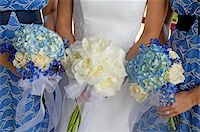 Image of a bride and two bridesmaids holding bouquets Stock Photo - Royalty-Freenull, Code: 400-04162133