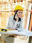 female architect talking on mobile phone in construction site Stock Photo - Royalty-Free, Artist: diego_cervo, Code: 400-04162902