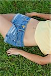 Teenage Girl with Bare Midriff Lying on Grass Stock Photo - Premium Rights-Managed, Artist: dk & dennie cody, Code: 700-04163451