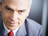 closeup of mature business man looking at camera. Copy space Stock Photo - Royalty-Freenull, Code: 400-04163638