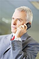 portrait of mature business man talking on the phone, looking away. Stock Photo - Royalty-Freenull, Code: 400-04163804