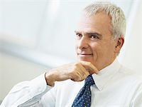 portrait of mature business man with hand on chin, looking away. Copy space Stock Photo - Royalty-Freenull, Code: 400-04163805
