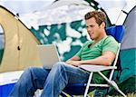 Camper using laptop Stock Photo - Royalty-Free, Artist: avava, Code: 400-04167764
