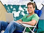 Camper using laptop Stock Photo - Royalty-Free, Artist: avava, Code: 400-04167765