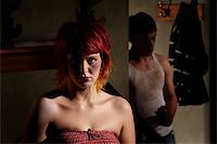 Frightened young woman with menacing alcoholic man Stock Photo - Royalty-Freenull, Code: 400-04175152