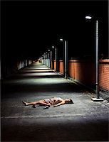 Girl lies motionless in the street Stock Photo - Royalty-Freenull, Code: 400-04178263