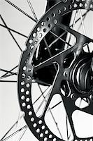 Disc brake rotor on a mountain bike front wheel Stock Photo - Royalty-Freenull, Code: 400-04180141