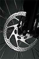 Mountain bike front wheel with mechanical disc brake Stock Photo - Royalty-Freenull, Code: 400-04180144