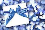 Blue Holiday or Birthday Gift on Abstract Background Stock Photo - Royalty-Free, Artist: tobkatina, Code: 400-04182314