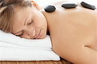 Relaxed woman lying on a massage table having a stone therapy Stock Photo - Royalty-Freenull, Code: 400-04192061