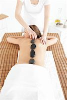 Delighted woman having a massage against a white background Stock Photo - Royalty-Freenull, Code: 400-04192072