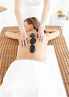 Cute woman having a massage against a white background Stock Photo - Royalty-Freenull, Code: 400-04192073