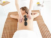 Attractive woman lying on a massage table against a white background Stock Photo - Royalty-Freenull, Code: 400-04192074