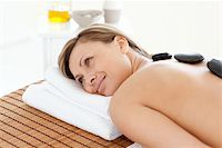 Cute woman relaxing on a massage table against a white background Stock Photo - Royalty-Freenull, Code: 400-04192083