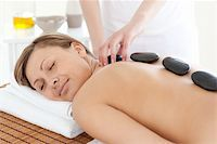 Bright woman relaxing on a massage table against a white background Stock Photo - Royalty-Freenull, Code: 400-04192084