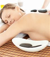Portrait of a radiant woman having a massage with stones at the spa Stock Photo - Royalty-Freenull, Code: 400-04192105