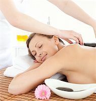 Portrait of a relaxed woman having a massage with stones at the spa Stock Photo - Royalty-Freenull, Code: 400-04192109