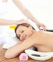 Portrait of a confident woman having a massage with stones at the spa Stock Photo - Royalty-Freenull, Code: 400-04192111