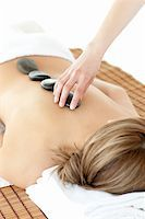 Caucasian woman having a stone therapy against a white background Stock Photo - Royalty-Freenull, Code: 400-04192119