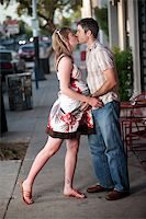 Pregnant woman kissed by her husband on the street Stock Photo - Royalty-Freenull, Code: 400-04194255