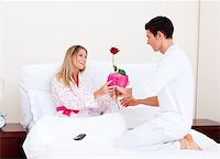 Adorable husband giving a present to his wife in the bedroom Stock Photo - Royalty-Freenull, Code: 400-04195867