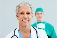 Close up of a senior Doctor standing in front of his team Stock Photo - Royalty-Freenull, Code: 400-04198411