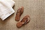 Flip flops with fluffy towels on seagrass rug Stock Photo - Royalty-Free, Artist: Sandralise, Code: 400-04199671