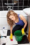 Unhappy woman cleaning the ground of a bathroom Stock Photo - Royalty-Free, Artist: 4774344sean, Code: 400-04201115
