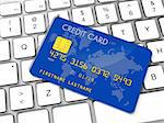 Blue credit card on a computer keyboard Stock Photo - Royalty-Free, Artist: daboost, Code: 400-04204342