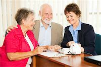 Senior couple gets good financial news from their accountant. Stock Photo - Royalty-Freenull, Code: 400-04208601