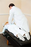 Chiropractor aligning a patient's vertebrae in his office. Stock Photo - Royalty-Freenull, Code: 400-04208940