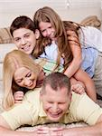 Full portrait of a happy family lying on bed and having great time Stock Photo - Royalty-Free, Artist: get4net, Code: 400-04209036