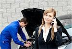 Man repairing black car of business woman Stock Photo - Royalty-Free, Artist: 4774344sean, Code: 400-04209383
