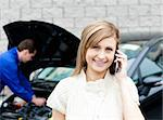 Man repairing black car of phoning woman Stock Photo - Royalty-Free, Artist: 4774344sean, Code: 400-04209387