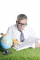 senior student teacher humor glasses world map book big pencil green grass desk Stock Photo - Royalty-Freenull, Code: 400-04210365