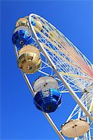 Detail of Merry-go-round against blue sky Stock Photo - Royalty-Freenull, Code: 400-04210702