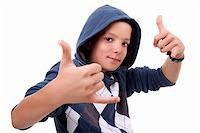 boy with his hands rise up as a sign of everything cool, isolated on white background Stock Photo - Royalty-Freenull, Code: 400-04213579