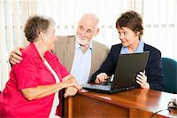 Senior couple with their financial advisor, going over their retirement income on her computer. Stock Photo - Royalty-Freenull, Code: 400-04217556