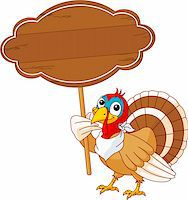 Thanksgiving Turkey holding blank sign . Isolated on a white background. Stock Photo - Royalty-Freenull, Code: 400-04218128