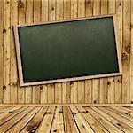 Empty school blackboard at wall in wooden interior