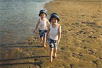 Twin boys Walking on Beach Stock Photo - Premium Royalty-Freenull, Code: 600-04223562