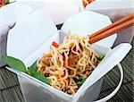 Take away egg noodles on chopsticks in a take away container. Stock Photo - Royalty-Free, Artist: jabiru, Code: 400-04224394