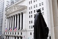 stock exchange building - NEW YORK CITY - FEB 3: Washington Statue and New York Stock Exchange in Wall Street during United States economy recovery, February 3, 2010 in Manhattan, New York City. Stock Photo - Royalty-Freen