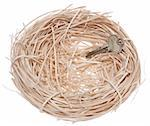 Key in a nest symbolizes the purchase of a new home.  Isoalted on white with a clipping path. Stock Photo - Royalty-Free, Artist: brookebecker, Code: 400-04231953