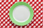 the green plate on checkered tablecloth Stock Photo - Royalty-Free, Artist: jirkaejc, Code: 400-04237499