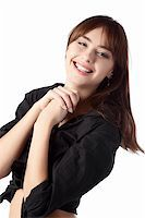 casual girl standing up over a white background Stock Photo - Royalty-Freenull, Code: 400-04238684