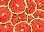 Abstract red background with citrus-fruit of grapefruit slices. Close-up. Studio photography. Stock Photo - Royalty-Free, Artist: boroda, Code: 400-04239203