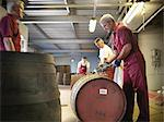 Worker with whisky barrel in distillery Stock Photo - Premium Royalty-Free, Artist: Lloyd Sutton, Code: 649-04248740