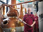 Worker with stills in distillery Stock Photo - Premium Royalty-Freenull, Code: 649-04248746